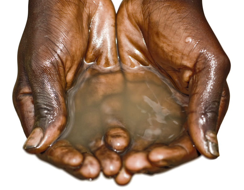 A boy's hands cupping water