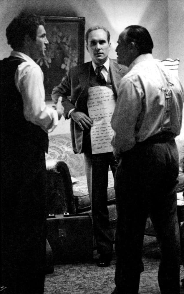 A picture of Marlon Brando reading from a cue card in 'The Godfather'